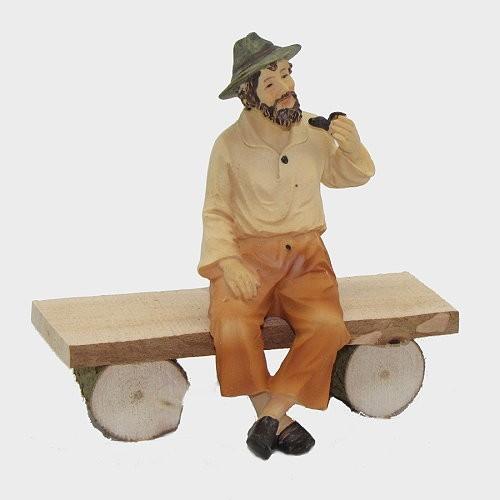 Krippenfigur Opa sitzend auf Bank