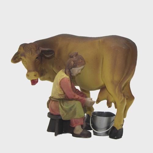 Krippenfigur Bäuerin mit Kuh beim Melken